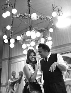 Claudia Cardinale and Federico Fellini on the set of 8 1/2